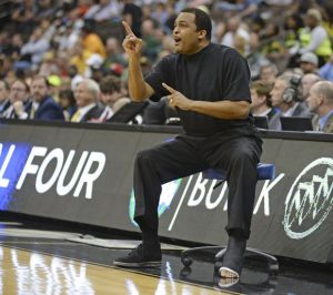 Georgia State head coach Ron Hunter directs his players on the court during the first half of an NCAA tournament second round college basketball game against Baylor, Thursday, March 19, 2015, in Jacksonville, Fla. (Rick Wilson | The Associated Press)