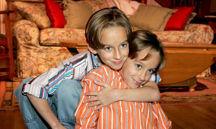 Actor Sawyer Sweeten (left) with his twin brother Sullivan in 2005. Photograph: Kevin Winter/Getty Images