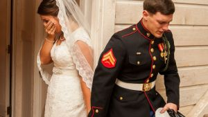U.S. Marine Cpl. Caleb Earwood prays with his bride-to-be Maggie before their wedding service on Saturday in Asheville, North Carolina. Courtesy Dwayne Schmidt