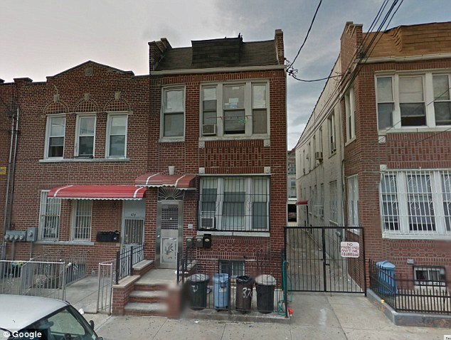 House of horrors: In the center, the Brooklyn home where five people were stabbed to death Saturday evening