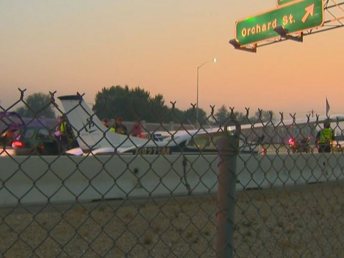 small airplane lands i 84