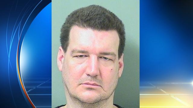 David Etzel is accused of biting his mother's shih tzu in the face, ripping out the dog's eye.