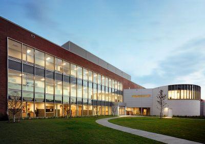 A modern technology center with many windows.