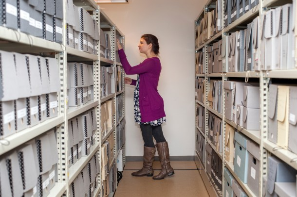 Elise Fariello pulls a photograph collection for a patron, one of many duties fulfilled during her year with the Historical Society.