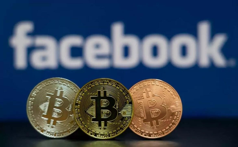 Logotipo do Facebook, e moedas digitais do Bitcoin