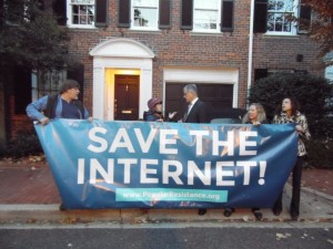 Activists greet FCC Chairman Tom Wheeler early in the morning at his house in Georgetown.