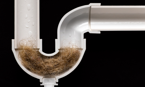 Hair Ball Clog in Drain Pipe