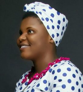 B.U.D Ebullient with a nice head tie. The pink neckline really made a difference. God bless you lady
