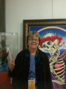 Julie Postel at the Grateful Dead Archive at UC Santa Cruz - Stanley Mouse art in background
