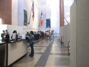 Room dividers in a museum create a hallway for guests to separate paying guests from the entryway