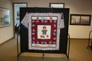A boy sports themed handmade quilt