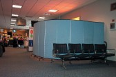 Screenflex Room Dividers create barrier walls in an airport.