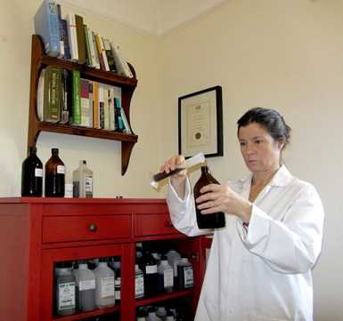 Deanne Greenwood preparing herbal remedies in her dispensary. The herbs Deanne uses in her practice are all sourced from reputable suppliers and are organic where ever possible. Deanne also makes some of her own herbal remedies from plants she grows herself, or finds growing in the wild, in Cornwall. Deanne Greenwood, a medical herbalist, practices in Falmouth, Helston and Penzance in Cornwall. Deanne Greenwood also does telephone and Skype consultations for people who live in other parts of the UK. Deanne Greenwood is fully qualified and insured. She has a BSc (Hons) in herbal Medicine. Deanne Greenwood is a member of the College Of Practitioners Of Phytotherapy MCPP.