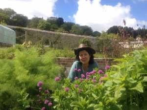 Deanne Greenwood Medical Herbalist in her herb garden