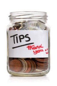 Tip jar with British currency and label saying thank you