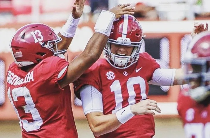 Mac Jones is congratulated on his dueling Alabama player