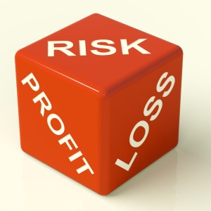 Profit Loss And Risks Red Dice Showing Market Uncertainty