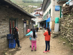 Children playing in the alley