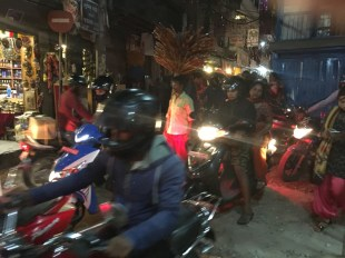 The street is crowded with motor bikes