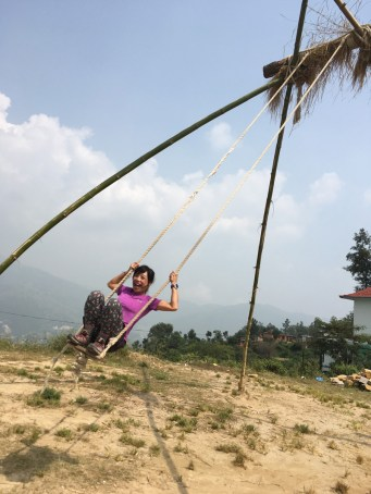Traditional swing made of bamboo and rope are set up for the Dashain celebration