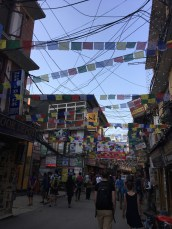 Streets of Thamel are decorated with colorful flags.