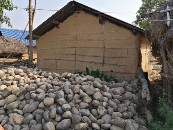 The wall of the house is built with bamboo lattice and covered with mud plaster
