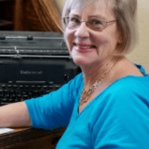 Author Debbie Burke at her desk