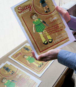 Holding Paper Doll Sheets