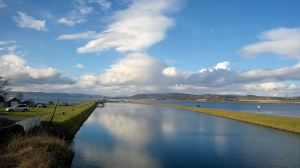 View to end of Caledonian Canal into Beaul;y Firth Ben Wyvis distance small