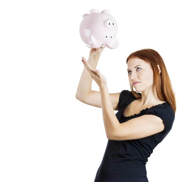Woman holding a piggy bank iStock_000035658988_Medium