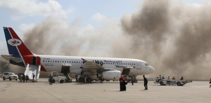 Dust rises after explosions hit Aden airport, upon the arrival of the newly-formed Yemeni government in Aden. Credit: Reuters Photo