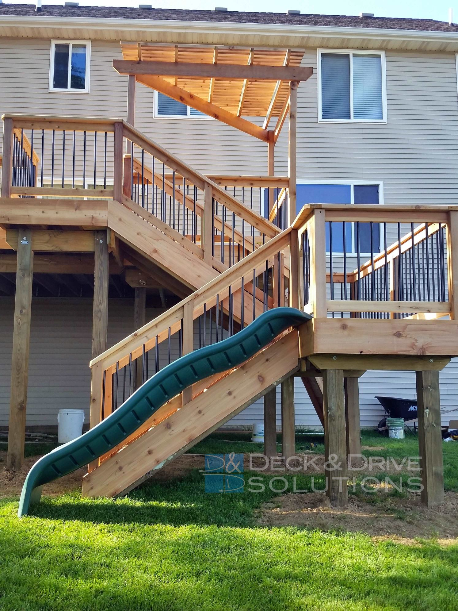 New Cedar Deck With Slide And Rock Wall Des Moines Deck
