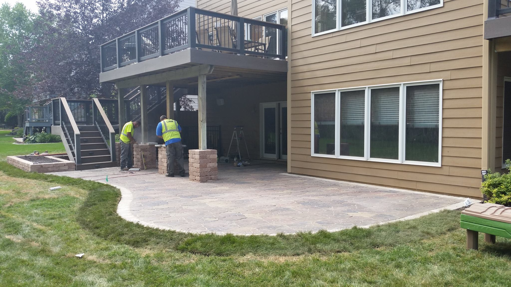 Double Decks, Under Deck System, and New Stone Patio | Des ... on Patio With Deck Ideas id=46507