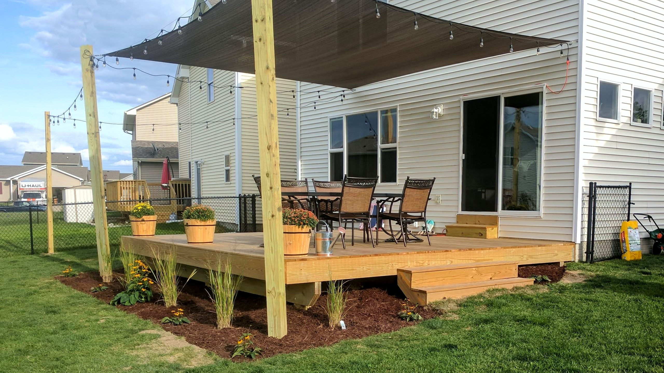 Sun Shade on New Deck | Des Moines Deck Builder - Deck and ... on Deck Over Patio Ideas id=12541