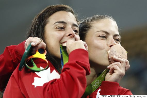 Canada's duet Meaghan Benfeito (L) and Roseline Filion celebrate during the podium ceremony of the Women's Synchronised 10m Platform Final after the diving event at the Rio 2016 Olympic Games at the Maria Lenk Aquatics Stadium in Rio de Janeiro on August 9, 2016.   / AFP / Odd ANDERSEN        (Photo credit should read ODD ANDERSEN/AFP/Getty Images)