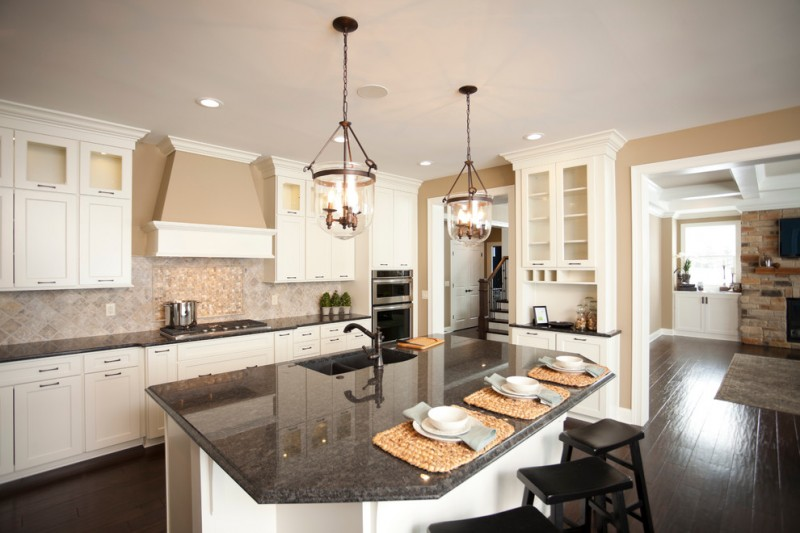 Relishing Cooking At Kitchen With White Cabinet And
