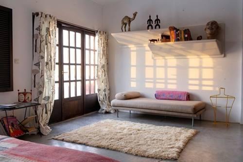 Una casa rústica de estilo marroquí con decoración retro 10
