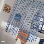 Separador de ambientes DIY con lanas de pompones