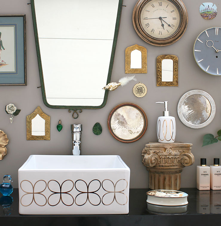 gray bathroom with mirror collection and silver cloverleaf painted vessel sink
