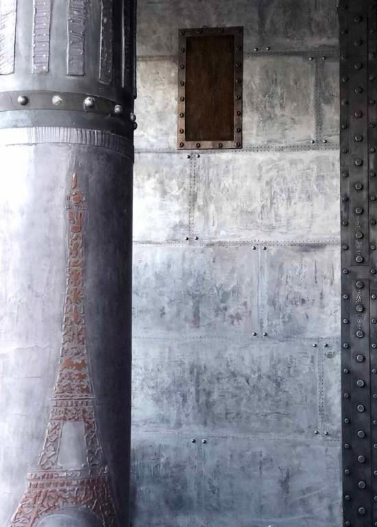 Loft style industriel avec colonne customisée eiffel et murs metal