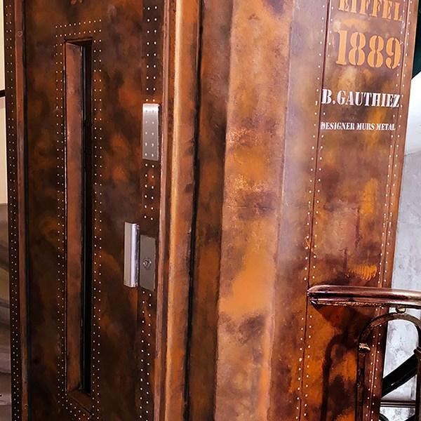 poutre métallique style Eiffel ascenseur oxydé