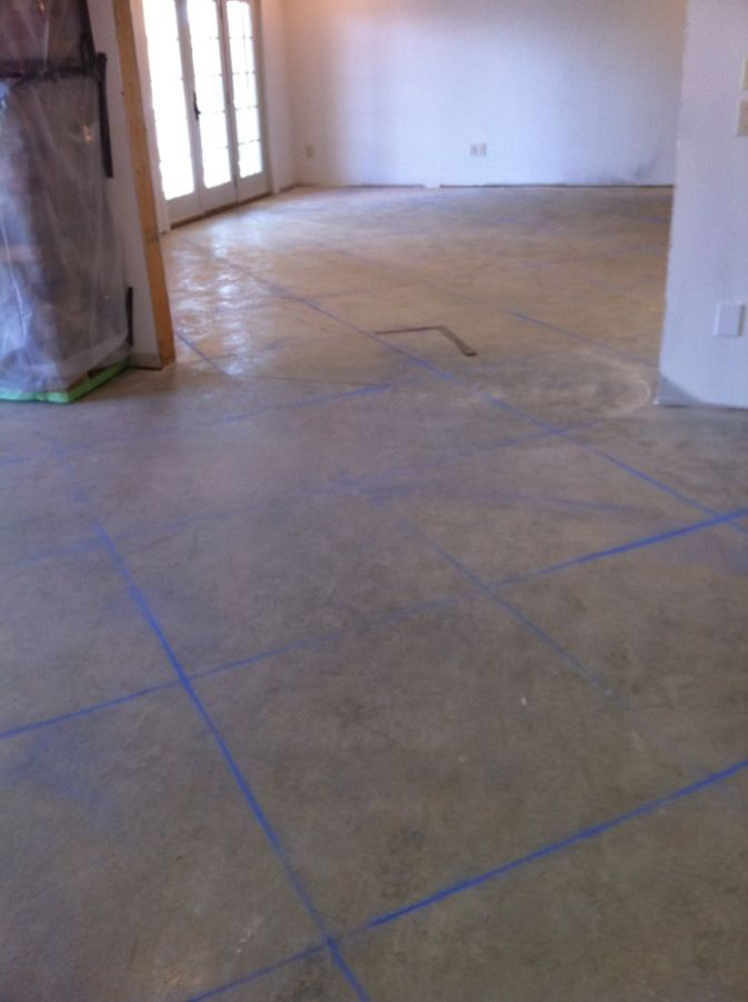 Scored Concrete Flooring : Scoring lines in a multi colored stained concrete floor