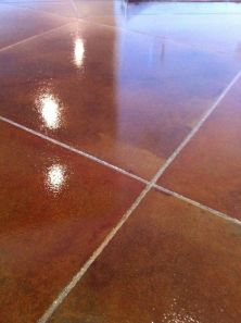 Concrete scored into a tile pattern and stained multiple colors