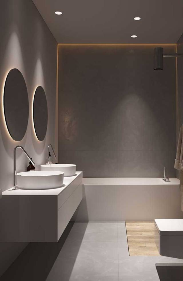 A fita de LED atrás dos espelhos do banheiro traz sensação de profundidade ao ambiente