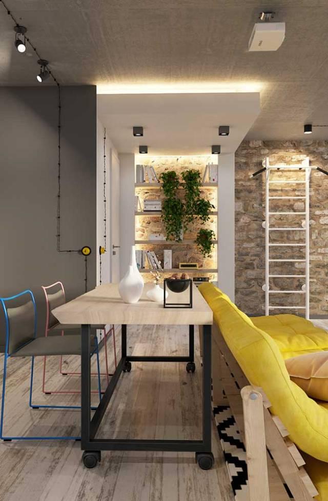 A fita de LED combinada à parede de pedra e as plantas traz uma rusticidade elegante para o ambiente integrado