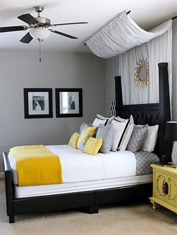 romantic bedroom with yellow bedspread