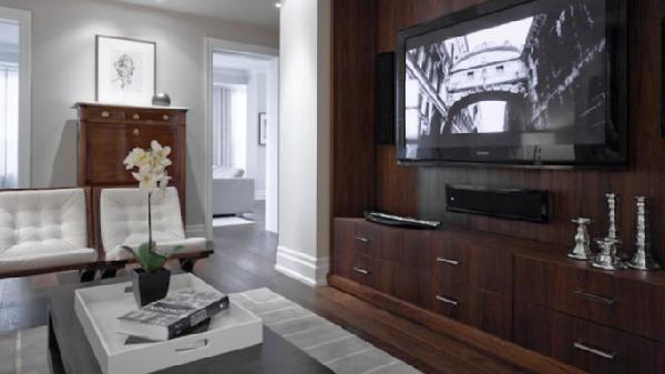 living rooms - wood entertainment center media unit modern wood coffee table white leather modern tufted chairs white lacquer tray silver candle holders gray walls paint color living room