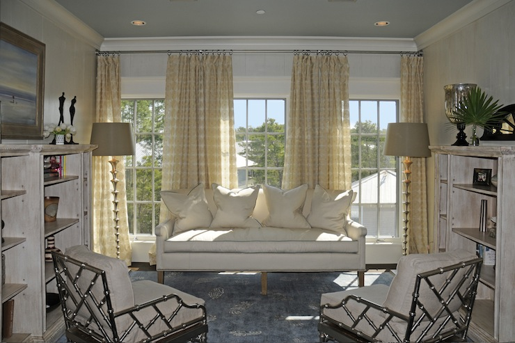 dens/libraries/offices - white sofa yellow drapes silver faux bamboo chairs floor lamps  Kim Fouquet  Butter yellow drapes, white sofa, floor
