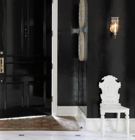 entrances/foyers - glossy black door walls white chair Rob Southern - Glossy black door and glossy black walls and white chair.