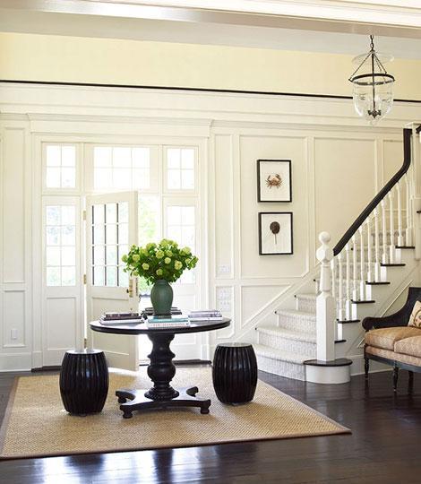 entrances/foyers - black garden stools black pedestal table sisal rug art  Ken Gemes Interiors & Tria Giovan Photography!  beautiful transitional